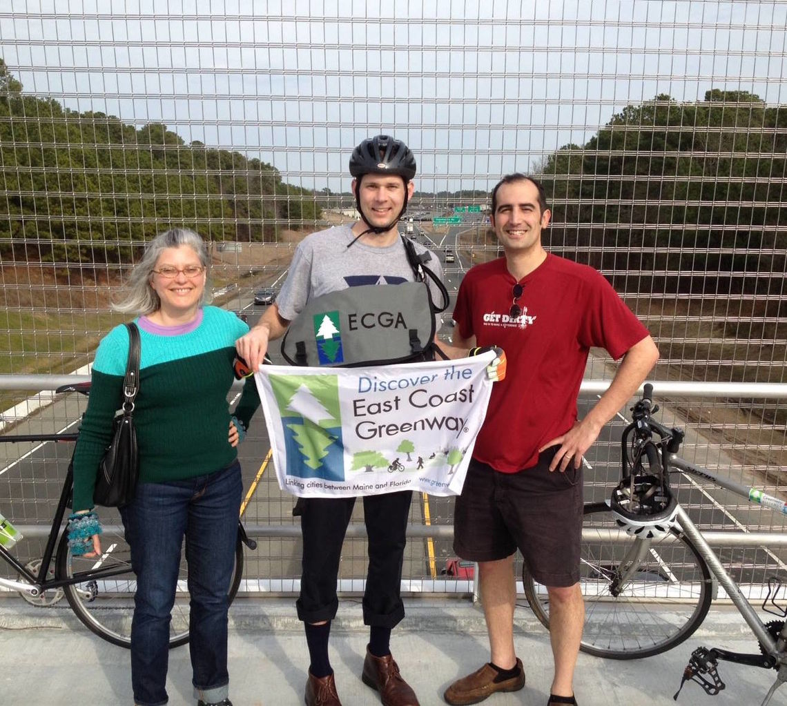 2014: Debbie West and Niles Barnes celebrate with Markatos-Soriano the opening of a bike-pedestrian bridge over Interstate 40 close to the Greenway headquarters in Durham, N.C.