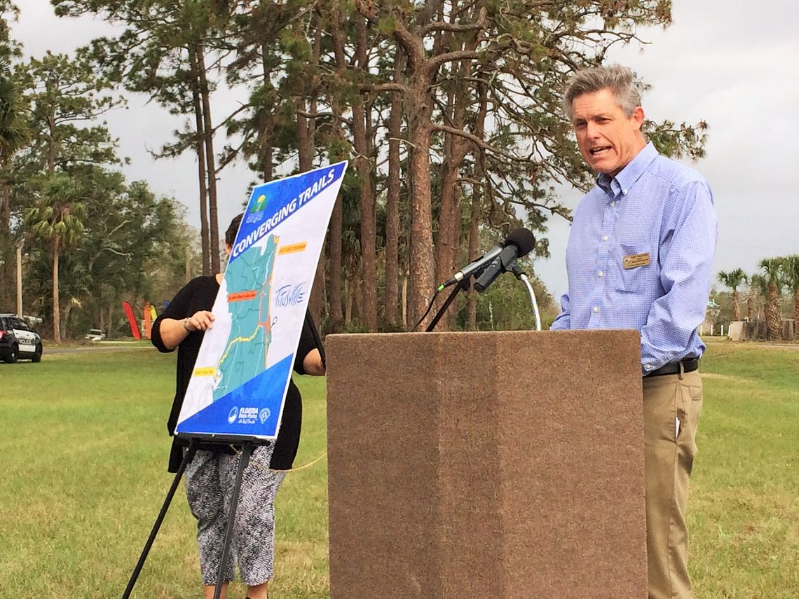 Eric Draper, director of the Florida State Parks System, greets attendees at the ribbon-cutting in Titusville.