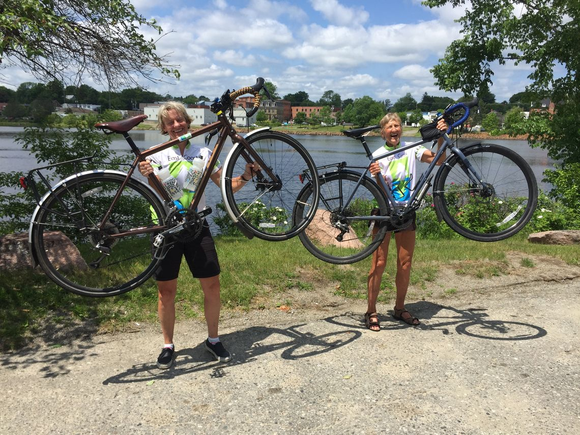 In Calais, Maine, across the St. Croix River from Canada, Lisa Watts and Dee Bird celebrate the finish of their ride up the Greenway from Key West.
