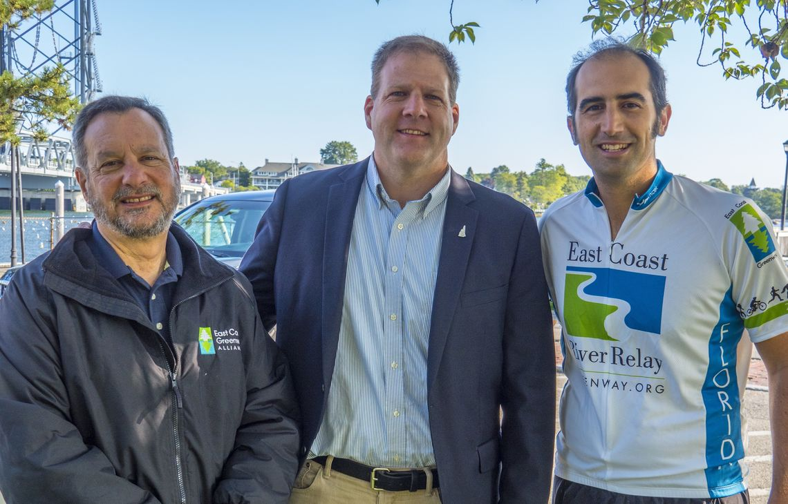 2017: Alliance trustee Robert Spiegelman (left) and Markatos-Soriano with N.H. Governor Chris Sununu in Portsmouth, N.H.The Alliance celebrated its 25th birthday with the East Coast River Relay, two months of events from Calais to Key West.