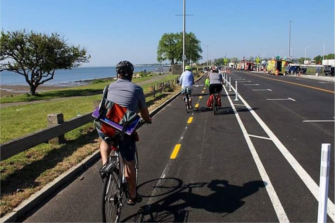 Near Long Wharf in New Haven, Connecticut, this cycle track -- a two-way bicycle lane, separated from motor vehicle traffic by delineators and paint -- is one of the newest segments of the East Coast Greenway.