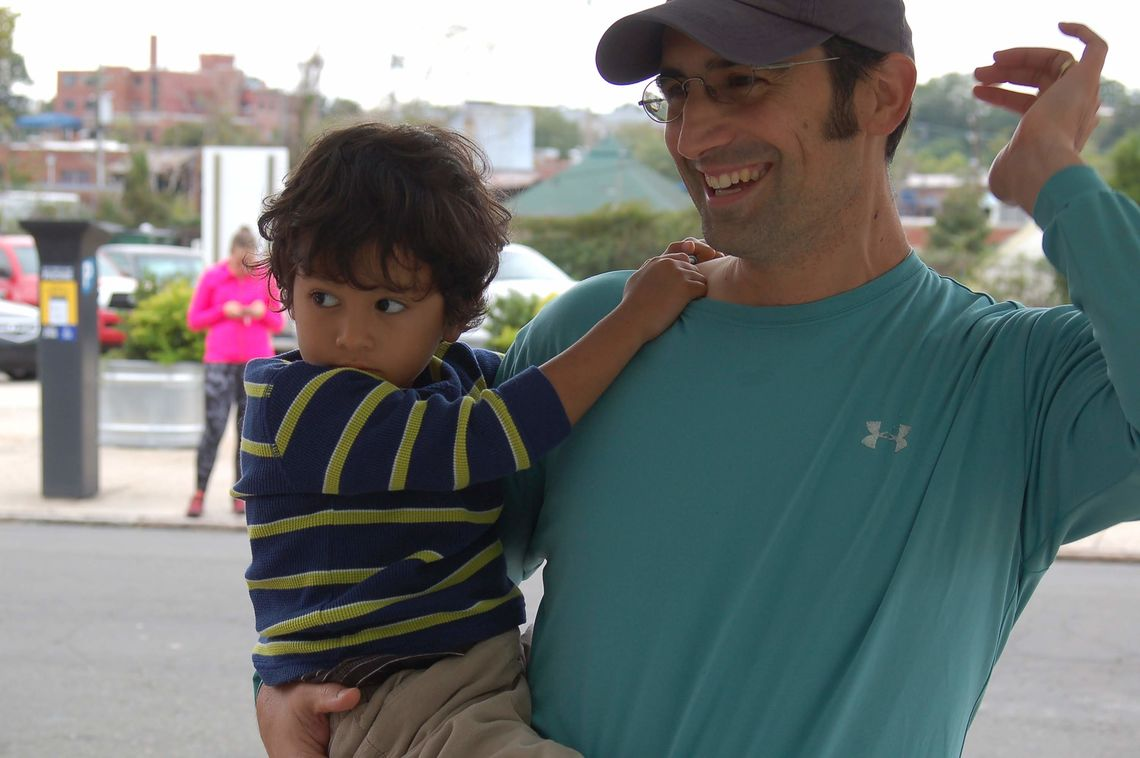 2018: Dennis and his youngest, Kristopher, cheer on runners at the Ales for Trails 5k in Durham, N.C.
